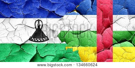 Lesotho flag with Central African Republic flag on a grunge crac