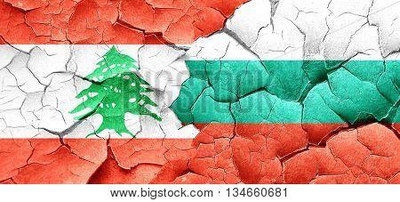 Lebanon flag with Bulgaria flag on a grunge cracked wall