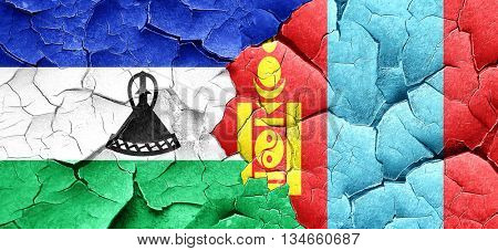 Lesotho flag with Mongolia flag on a grunge cracked wall
