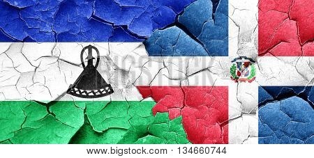 Lesotho flag with Dominican Republic flag on a grunge cracked wa