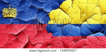 Liechtenstein flag with Colombia flag on a grunge cracked wall