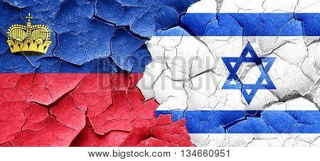 Liechtenstein flag with Israel flag on a grunge cracked wall