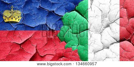 Liechtenstein flag with Italy flag on a grunge cracked wall