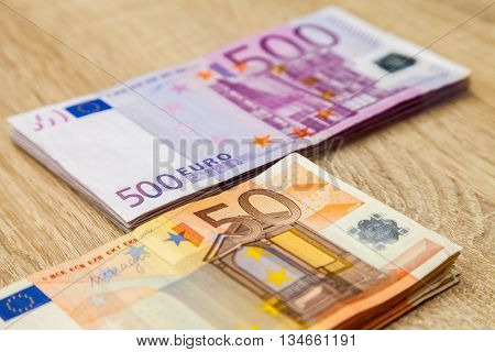 five hundred and fifty euro notes on a table