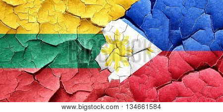 Lithuania flag with Philippines flag on a grunge cracked wall