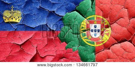 Liechtenstein flag with Portugal flag on a grunge cracked wall