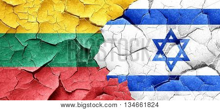 Lithuania flag with Israel flag on a grunge cracked wall