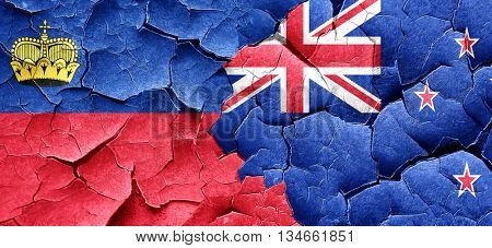 Liechtenstein flag with New Zealand flag on a grunge cracked wal