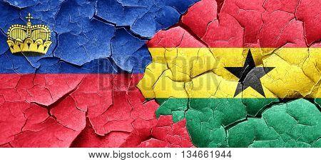 Liechtenstein flag with Ghana flag on a grunge cracked wall