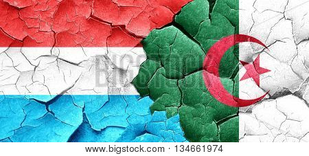 Luxembourg flag with Algeria flag on a grunge cracked wall