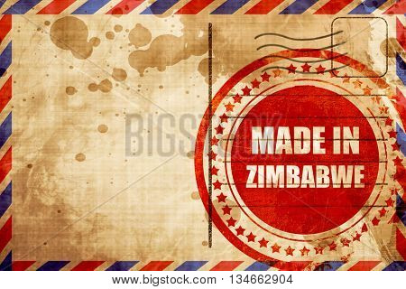 Made in zimbabwe, red grunge stamp on an airmail background