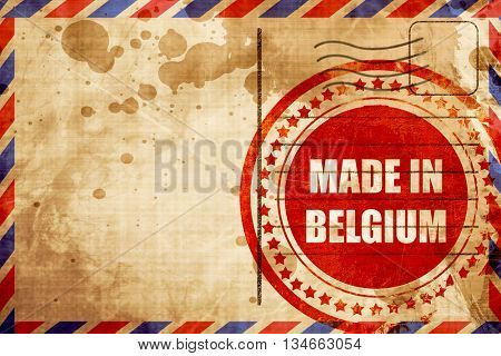 Made in belgium, red grunge stamp on an airmail background