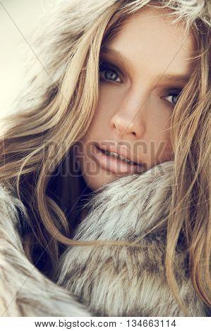 Beauty Fashion Model Girl In A Fur Hat. Winter Woman Portrait.