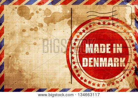 Made in denmark, red grunge stamp on an airmail background