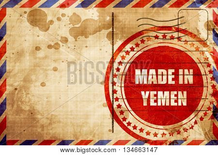 Made in yemen, red grunge stamp on an airmail background