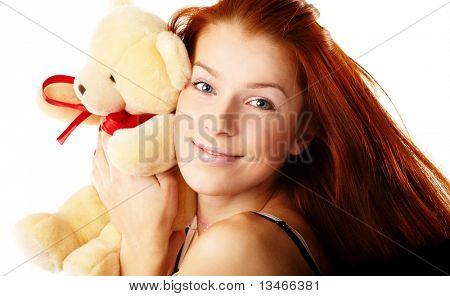 Beautiful woman holding a teddy bear
