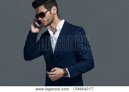 Young handsome man calling by phone, businessman