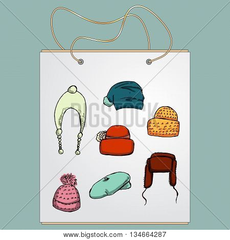 Shopping bag, gift bag with the image of fashionable things.Fashion set. Different hats. Illustration in hand drawing style.
