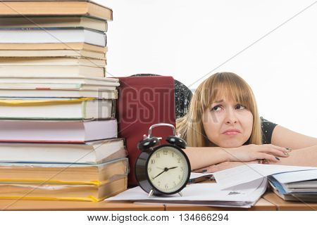 Student With Despair Looking At A Big Stack Of Books