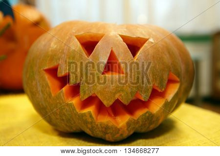 Head Pumpkin Halloween, holiday is celebrated October, eve of all saints Day. Trappings of Halloween in a pumpkin head with a candle inside. Main symbol of the holiday is the Jack-o-lantern.