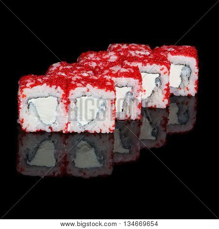 Sushi rolls with soft cheese and flying fish roe on black background