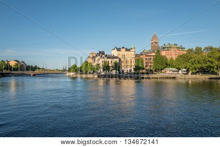 NORRKOPING, SWEDEN - JUNE 4, 2016: Summer evening at Motala river in Norrkoping. Norrkoping is a historic industrial town in Sweden.