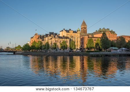 NORRKOPING, SWEDEN - JUNE 5, 2016: Summer evening at Motala river in Norrkoping. Norrkoping is a historic industrial town in Sweden.