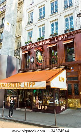 Paris France-June 09 2016: The famous brasserie Lipp is establishment on the boulevard Saint Germain. Hemingway wrote his dispatches from here. Chagall Camus and Montand were all regular habitues.