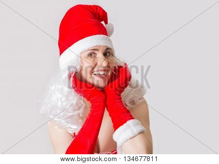 Beautiful young woman portrait in Santa Clause costume. Christmas background
