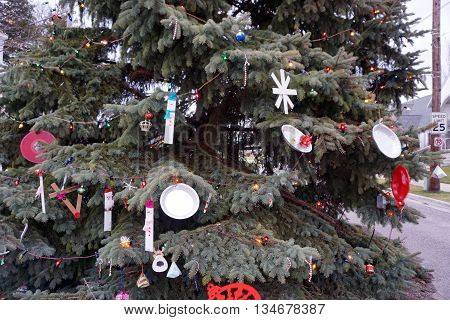 HARBOR SPRINGS, MICHIGAN / UNITED STATES - DECEMBER 24, 2015: Ornaments made by children decorate the Christmas tree on Main Street in downtown Harbor Springs.