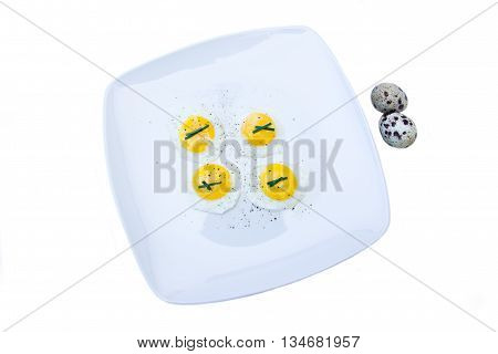 Fried quail eggs on a white background seen from above