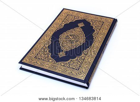 Qur'an or Koran is the central religious text of Islam ,book isolated on white.