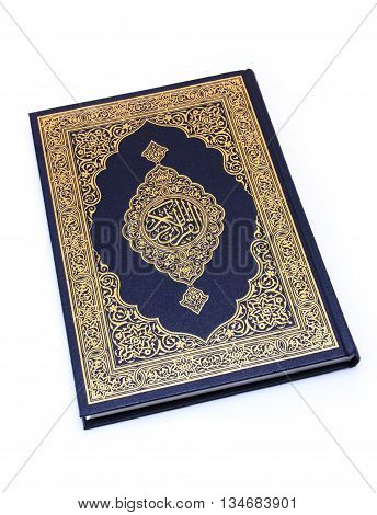 Qur'an or Koran is the central religious text of Islam which Muslims believe,book isolated on white.