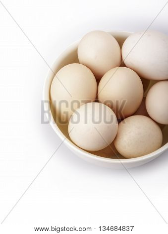 Chicken eggs on a plateEggs are laid by female animals and have been eaten by humans for thousands of years.