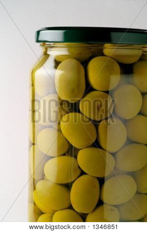 Glass Jar Of Preserved Olives (Horizontal Closeup)