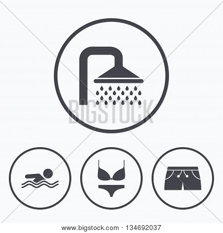 Swimming pool icons. Shower water drops and swimwear symbols. Human swims in sea waves sign. Trunks and women underwear. Icons in circles.