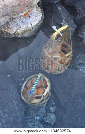 boiling a basket of eggs inside hot spring park
