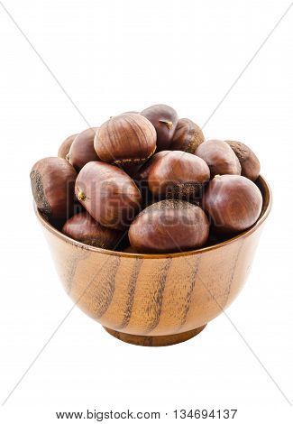 Sweet chestnut in wooden bowl isolated on white background