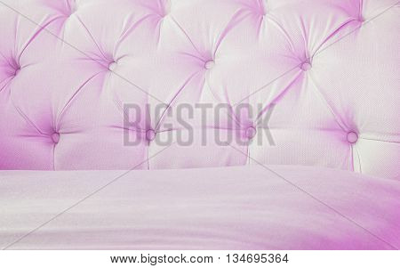 Closeup surface pink fabric at the sofa textured background
