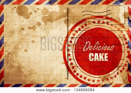 Delicious cake sign, red grunge stamp on an airmail background