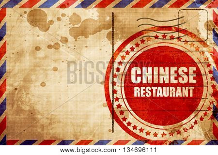 Delicious chinese restaurant, red grunge stamp on an airmail