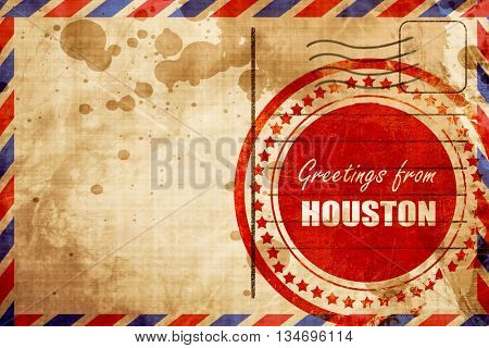 Greetings from houston, red grunge stamp on an airmail background