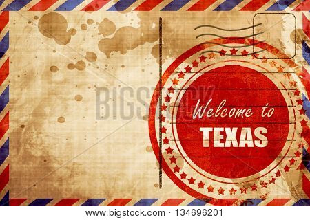 Welcome to texas, red grunge stamp on an airmail background