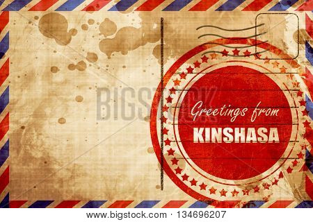 Greetings from kinshasa, red grunge stamp on an airmail background