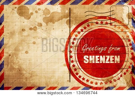 Greetings from shenzen, red grunge stamp on an airmail backgroun