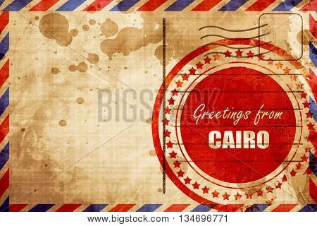 Greetings from cairo, red grunge stamp on an airmail background