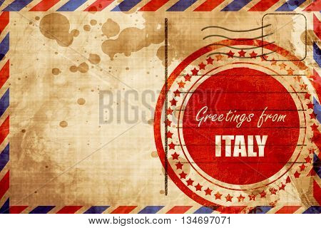 Greetings from italy, red grunge stamp on an airmail background