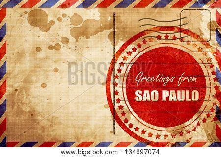 Greetings from sao paulo, red grunge stamp on an airmail backgro