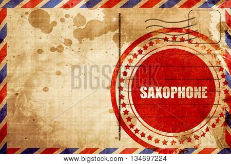saxophone, red grunge stamp on an airmail background