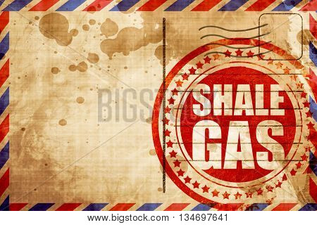 shale gas, red grunge stamp on an airmail background